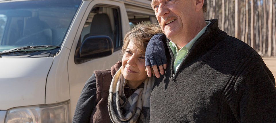couple and caravan