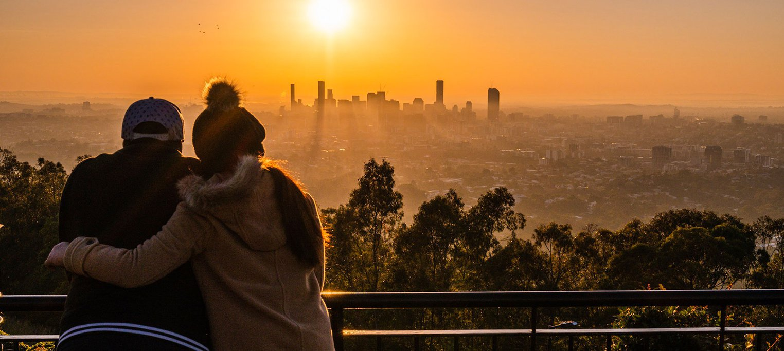 Couple watches sun set over Brisbane