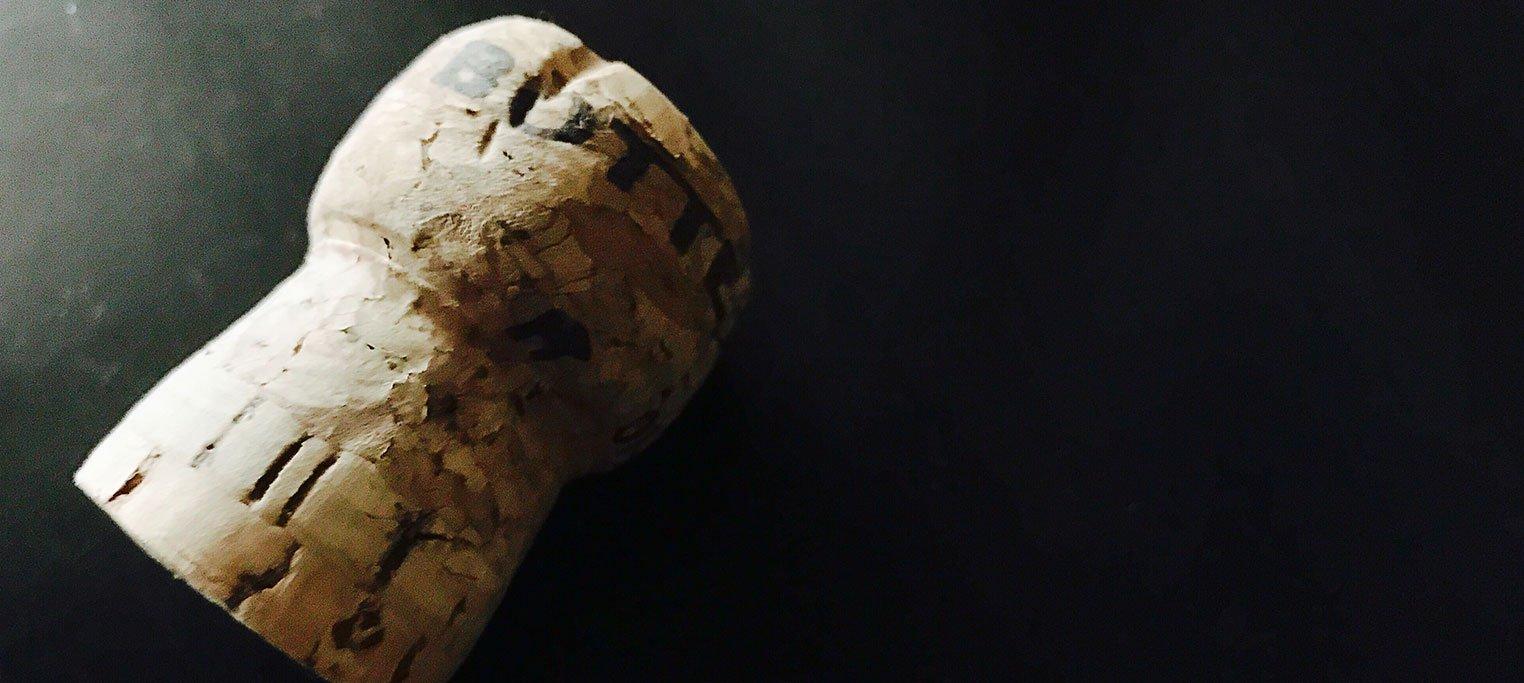 Wine cork on black background