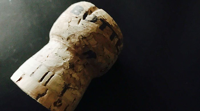 Wine cork on black background