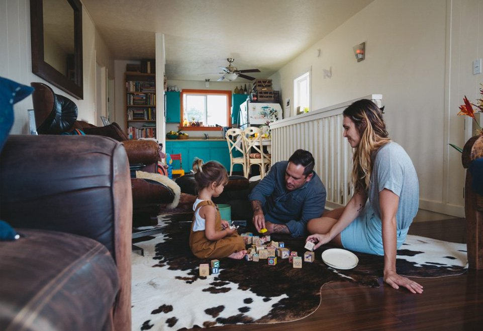 Family playing blocks with child