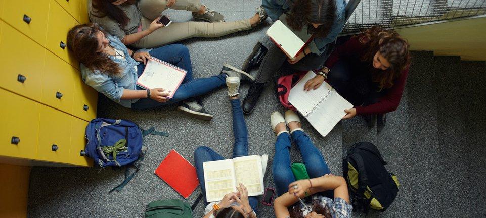 high school girls study in corridor