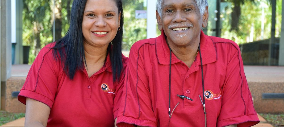 father and daughter in red polo shirts