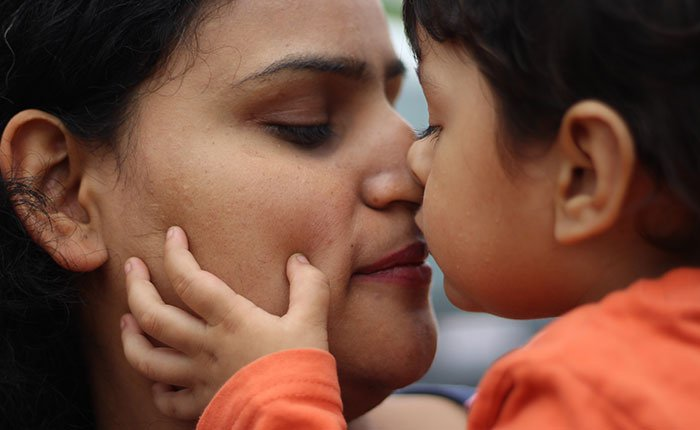 Mother and child kiss