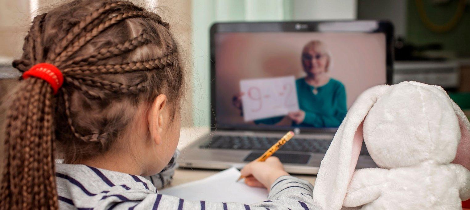 little girl doing online education