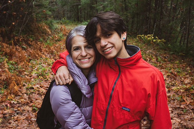 Mother and teenage son pose for picture on nature trail