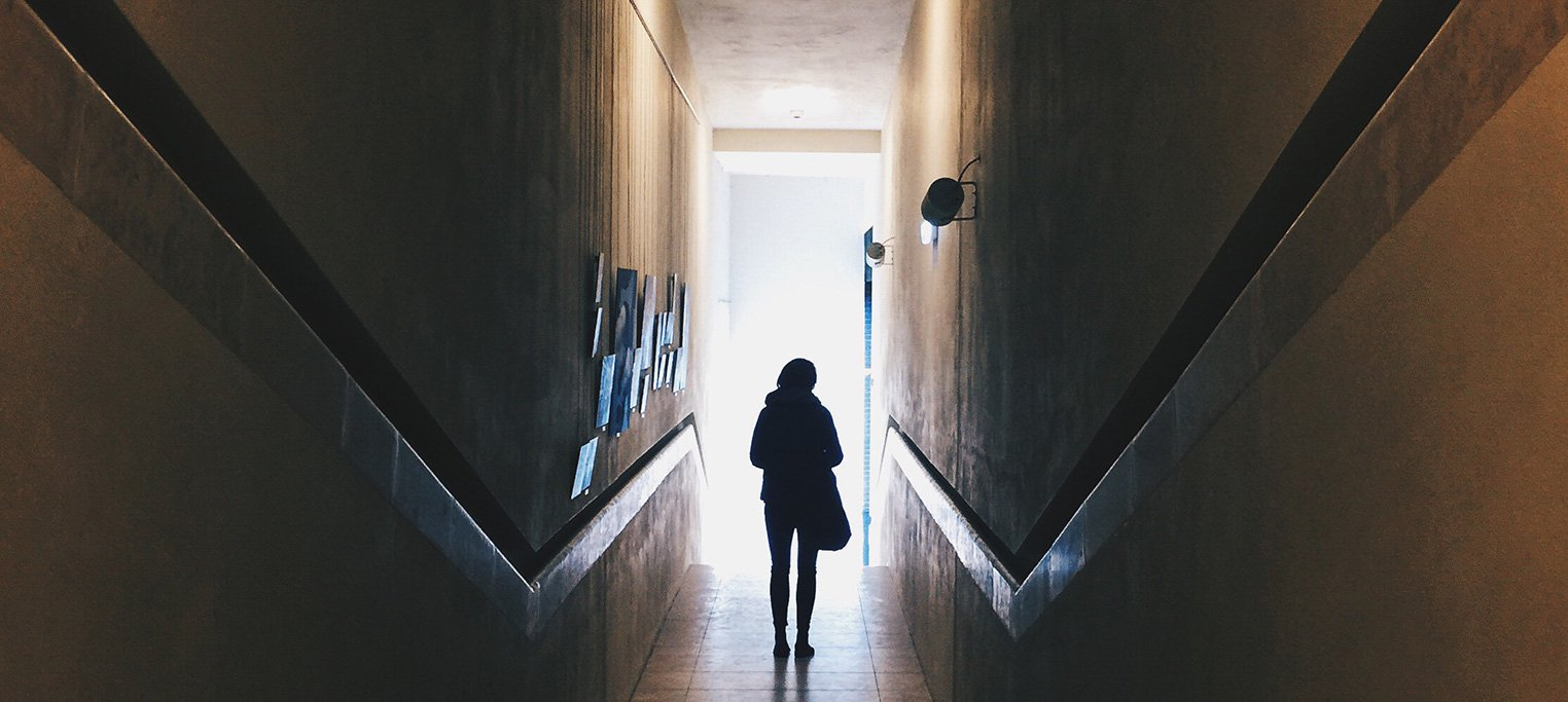 Silhouette of lone person in hallway