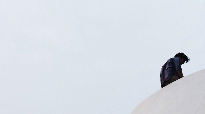 man alone on white background - coronavirus related article