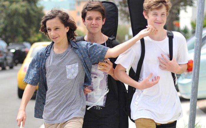 Teenagers walk to band practice