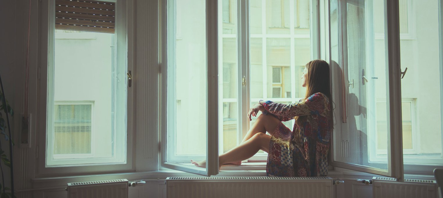 woman alone in home window